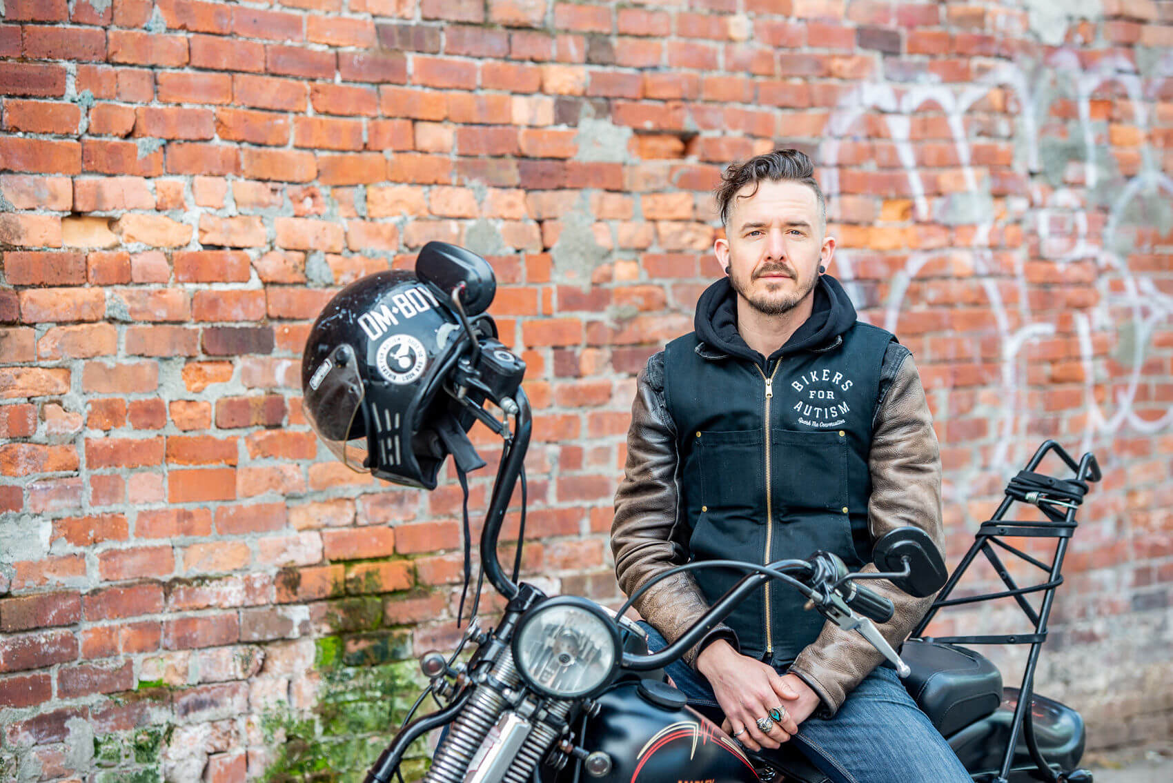 Tough Duck Brand Ambassador James Baker sitting on a motorcycle