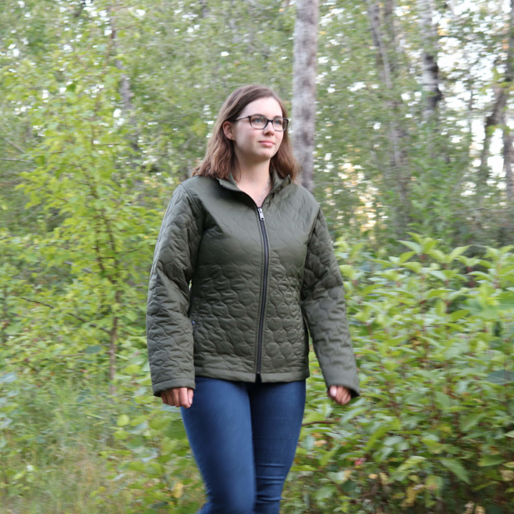Young woman walking in the woods in a WJ29 Women's Quilted Jacket